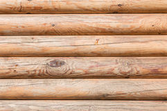 Closeup texture of the walls made of logs in the sun Royalty Free Stock Images
