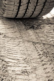 Closeup texture wheel with tyre tracks (focus on tire track) Stock Image