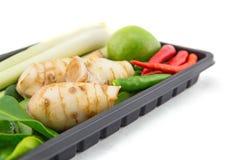 Closeup of Thai ingredients, galangal, lime, lemongrass Royalty Free Stock Photos