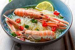 Closeup of Thai soup with scampi and noodles Stock Images