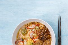 Closeup Thai Style Spicy Egg Noodle Soup With Wanton Stock Photo