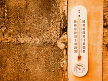 Closeup thermometer showing temperature in degrees Celsius. Hot temperature stock image