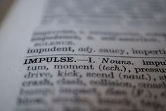 Closeup of the word impulse. Closeup of the thesaurus or dictionary definition of the word impulse royalty free stock images