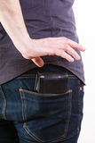 Closeup. Thief stealing wallet from back pocket of man. Theft. Stock Photos