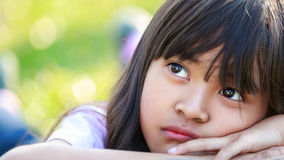 Closeup thinking liitle asian girl Royalty Free Stock Image