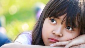 Closeup thinking liitle asian girl royalty free stock image