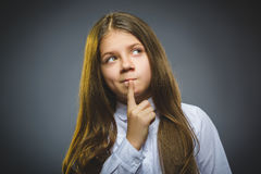 Closeup Thoughtful girl with Hand at head isolated on Gray stock photos