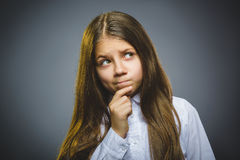 Closeup Thoughtful girl with Hand at head isolated on Gray royalty free stock photos