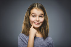 Closeup Thoughtful girl with Hand at head isolated on Gray stock image