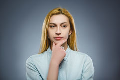 Closeup Thoughtful woman with Hand at head isolated on Gray Stock Photos