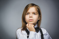 Closeup Thoughtful Young girl Looking Up Against Gray Background Royalty Free Stock Photography