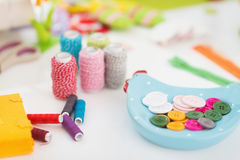 Closeup on threads and buttons on table for easter Stock Image