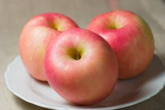 Closeup of three apples - fuji Stock Photo