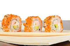 Closeup of three California maki sushi in row Royalty Free Stock Photography