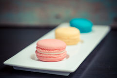 Closeup of three french macaroon cookies Royalty Free Stock Image