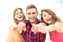 Closeup of three happy young people showing hands forward Royalty Free Stock Images