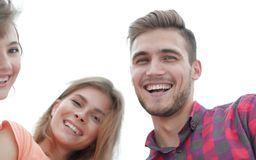 Closeup of three young people smiling on white background Royalty Free Stock Photography