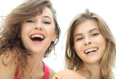 Closeup of three young people smiling on white background. Closeup of three happy young people smiling over white background Royalty Free Stock Photography