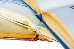 Closeup of three old books. Closeup of three old opened books spine Stock Image
