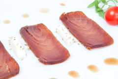Closeup of the three slices of smoked tuna. Stock Photo