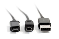 Closeup of three USB plugs isolated on white Royalty Free Stock Photography