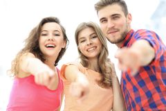 Closeup of three young people showing hands forward Royalty Free Stock Photo