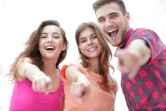 Closeup of three young people showing hands forward Stock Images