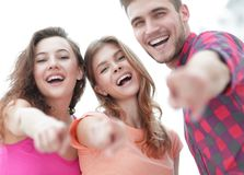 Closeup of three young people showing hands forward Stock Image