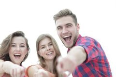 Closeup of three young people showing hands forward. The concept of perspectives Royalty Free Stock Images