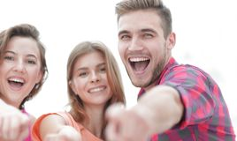 Closeup of three young people showing hands forward. The concept of perspectives Stock Photos