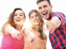 Closeup of three young people showing hands forward. The concept of perspectives Stock Photo