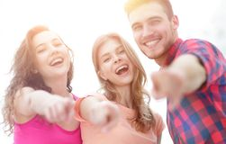 Closeup of three young people showing hands forward. The concept of perspectives Royalty Free Stock Photo