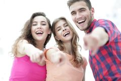 Closeup of three young people showing hands forward Royalty Free Stock Photography