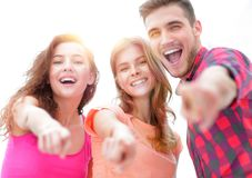 Closeup of three young people showing hands forward. The concept of perspectives Royalty Free Stock Photos