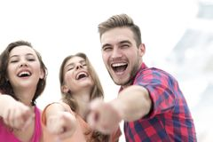 Closeup of three young people showing hands forward. The concept of perspectives Royalty Free Stock Photography