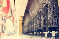 Closeup of Tibetan praying wheels. Royalty Free Stock Image