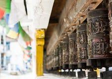 Closeup of Tibetan praying wheels. Stock Photo