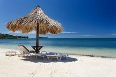 Closeup of Tiki hut on caribbean beach off the coast of Honduras Royalty Free Stock Photography