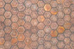 Closeup till åldrig sexhörning formad bakgrund för golvtegelplatta royaltyfria bilder