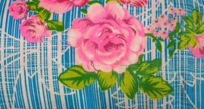 Closeup till rosa tyg för rosblommatappning Royaltyfri Fotografi