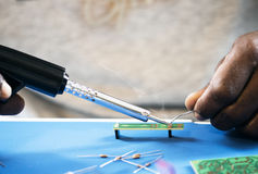 Closeup of tin soldering with electronics circuit board stock image