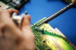 Closeup of tin soldering with electronics circuit board royalty free stock photo