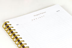 Closeup to agenda on project planner Royalty Free Stock Image