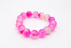Closeup to Beautiful Pink Amulet Made of Stones Bracelet, Isolated Stock Photography