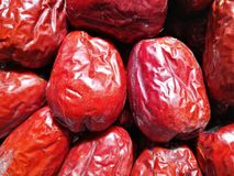 Big Red Date - Jujube Fruit. Closeup to a big Red Date - Jujube Fruit - /Fructus Jujubae among some small ones. They are different types. Ziziphus jujuba royalty free stock photography