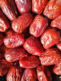 Big Red Date - Jujube Fruit. Closeup to a big Red Date - Jujube Fruit - /Fructus Jujubae among some small ones. They are different types. Ziziphus jujuba stock image