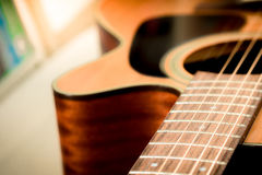 Closeup to body , pickguard and soundhole of acoustic guitar wit Stock Photography