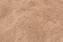 Closeup to Brown Sand on Ground Background Royalty Free Stock Photos