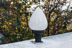 Closeup to Bud Lotus Shaped Outdoor Lamp in Garden Royalty Free Stock Photo