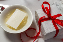 Closeup to Christmas wafer and a gift Royalty Free Stock Photos